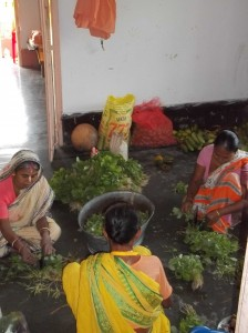 <h3> Local devotee didis cutting the collected vegetables for bhoga</h3>